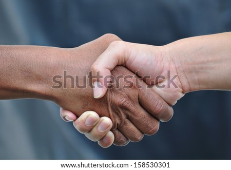 Handshake,gray background - stock photo