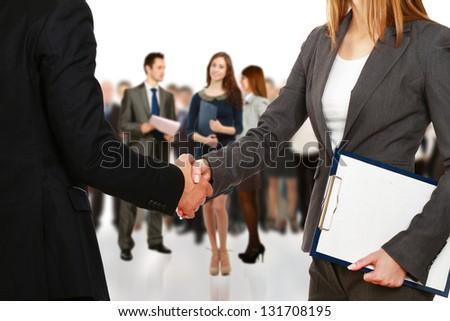 Handshake. Group of business people - stock photo
