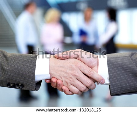 Handshake. Group of business people in a modern hall. Meeting.