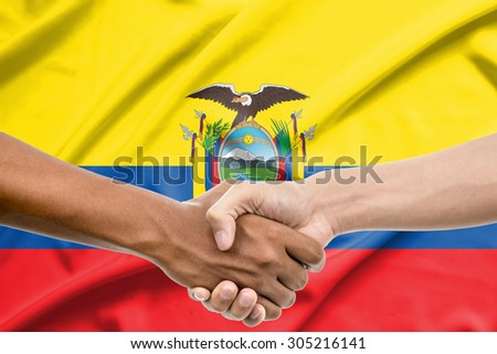 Handshake - Hand holding on Ecuador flag background - stock photo