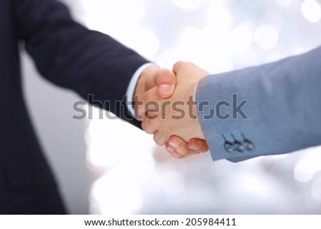 Handshake - Hand holding on white  - stock photo