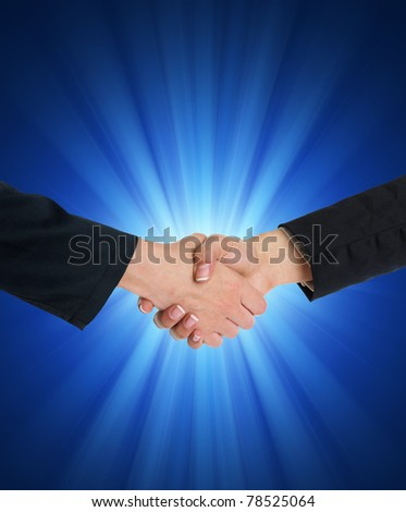 Handshake Handshaking and blurred blue flesh light in background - stock photo