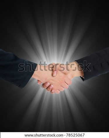 Handshake Handshaking and blurred blue flesh light in background
