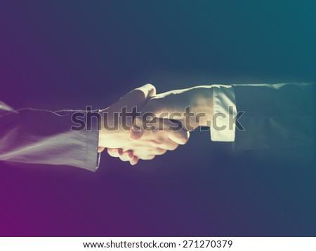 Handshake Handshaking light and dark - stock photo