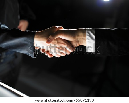 Handshake Handshaking light and dark