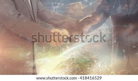 Handshake in agreement against image of a earth - stock photo