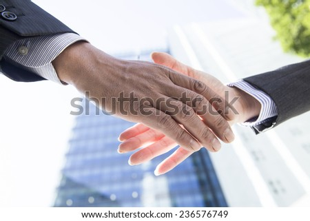 Handshake in business district