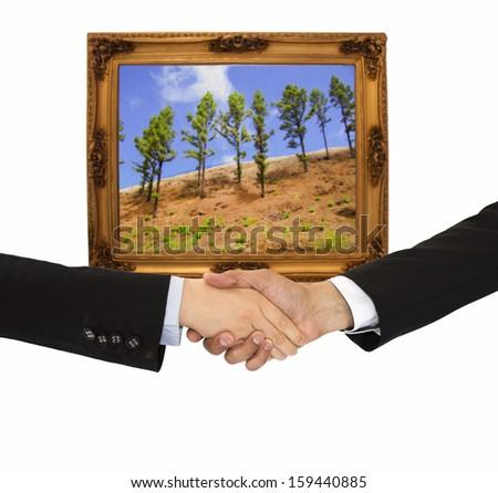 handshake in the business of art - stock photo