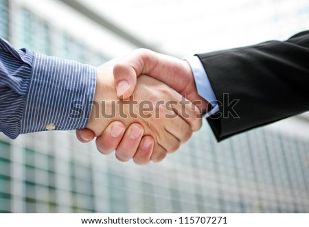 Handshake in the city - stock photo