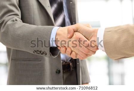 handshake isolated in office - stock photo