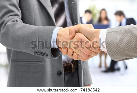 handshake isolated in office - stock photo