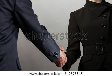 Handshake of business partners - man and woman - stock photo