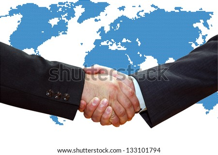 Handshake of business partners, over a map of the Earth.