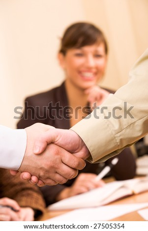 Handshake of business people with female manager at unfocused background
