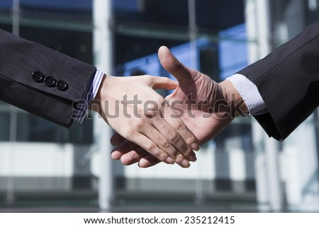 Handshake of businessman to celebrate the success