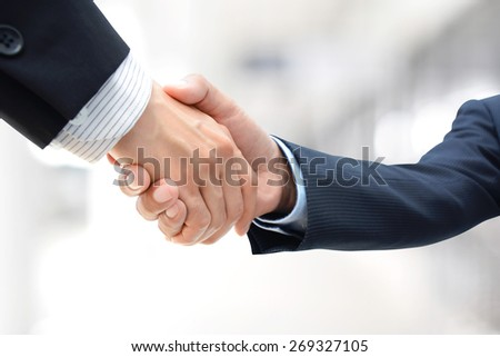 Handshake of businessmen - greeting , dealing, merger & acquisition concepts - stock photo