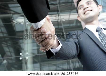 Handshake of businessmen; greeting, dealing, merger & acquisition concepts - soft focus - stock photo