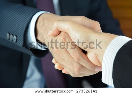 Handshake of businessmen - greeting , dealing, merger and acquisition concepts - stock photo