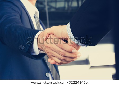 Handshake of businessmen - greeting, dealing, mergers and acquisition concept - stock photo
