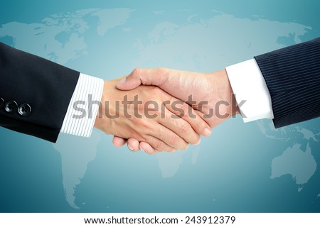 Handshake of businessmen - greeting, dealing, partnership, merger & acquisition concepts - stock photo