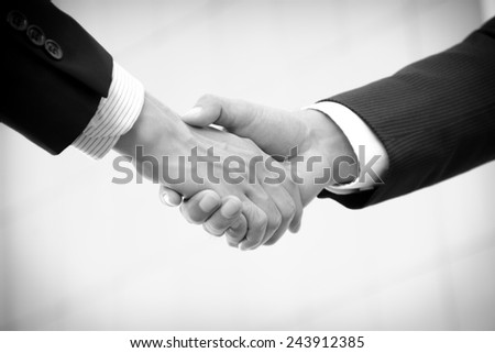 Handshake of businessmen, greeting, dealing, partnership, merger & acquisition concepts - monochrome effect