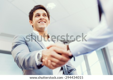 Handshake of businessmen greeting each other - stock photo