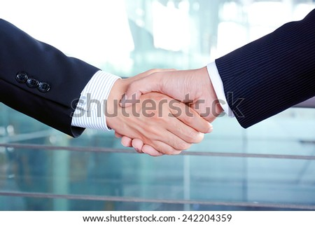 Handshake of businessmen - success, congratulation, greeting & business partner concepts - stock photo