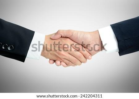 Handshake of businessmen - success, dealing, greeting & business partner concepts - stock photo