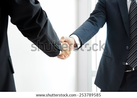 Handshake of businessmen; success, dealing, greeting & business partner concepts - soft focus  - stock photo