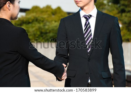 Handshake of men and women