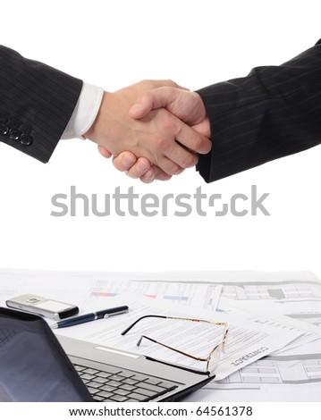 Handshake of two business partners - stock photo