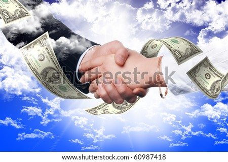 Handshake of two business people against the sky. Symbol of successful business - stock photo