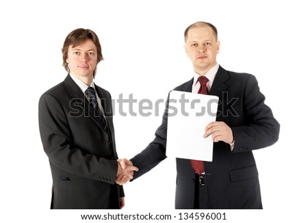 handshake of two businessmen signed a contract, isolated on white background - stock photo
