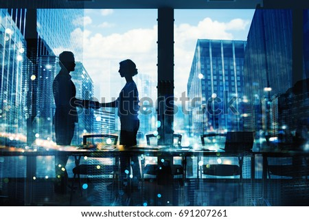 Handshake of two businessperson in office concept of partnership and teamwork