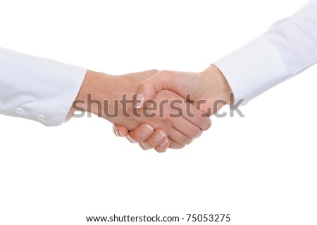 Handshake of women business partners in the office. Isolated on white background - stock photo