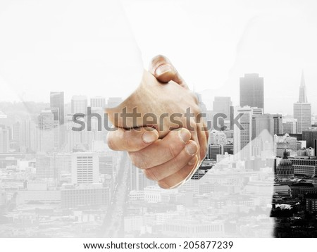 handshake on a city background - stock photo