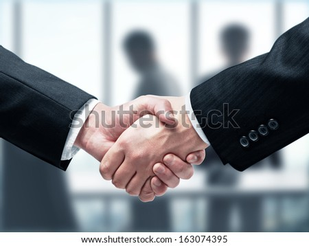 handshake on a gray background