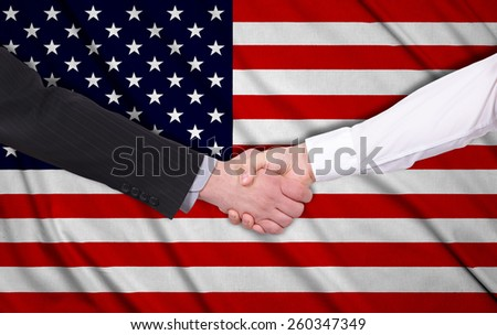 handshake on a USA flag background - stock photo