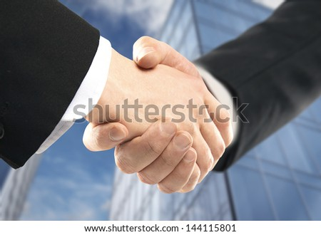 handshake on background of modern building