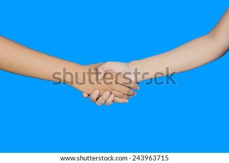 Handshake on blue background - stock photo