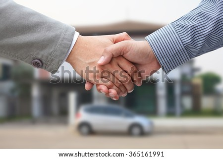 Handshake on house outdoor background, Real estate deal or sale concept. - stock photo