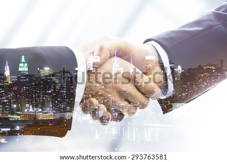 handshake on night city background, double exposure - stock photo