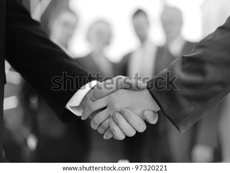 handshake on signing contract - stock photo