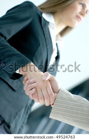 Handshake over abstract modern business background - stock photo