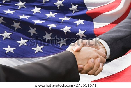 Handshake over american national flag background. Partnership and politics concept  - stock photo