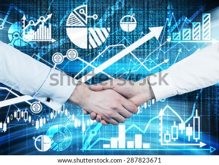 Handshake over the digital screen with charts and graphs. A concept of capital market transactions. - stock photo