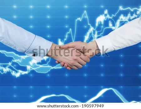 Handshake over the stock market chart  - stock photo