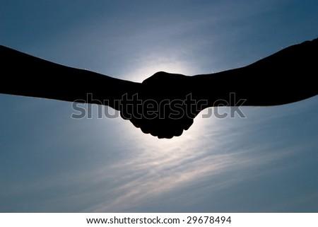 Handshake silhouette - stock photo