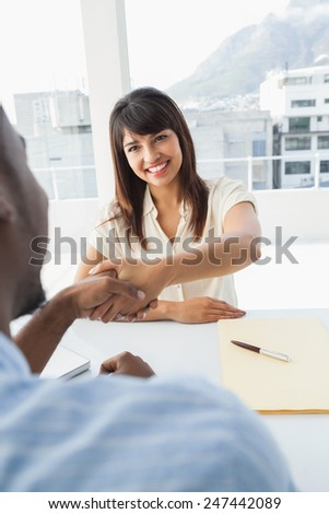 Handshake to seal a deal after a business meeting in the office - stock photo