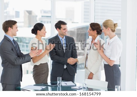 Handshake to seal a deal after a job recruitment meeting in an office - stock photo